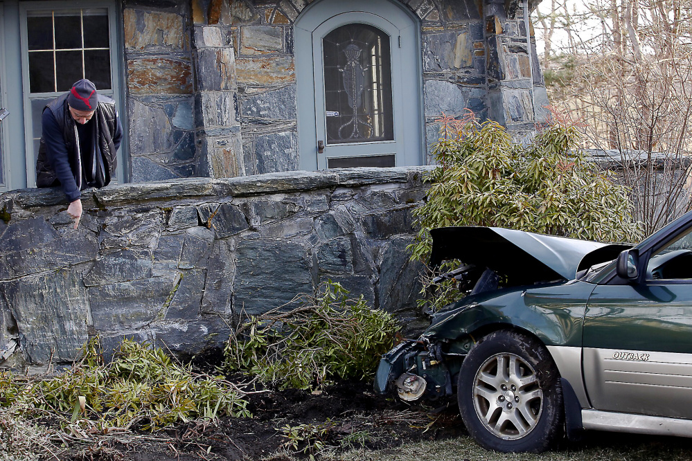 Christopher Lee describes the damage to his stone porch after a driver crashed into Lee's home Wednesday afternoon.