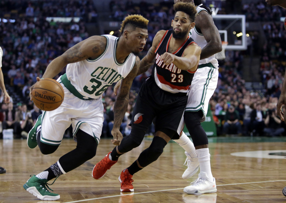 Celtics guard Marcus Smart drives on Portland Trail Blazers guard Allen Crabbe in the first quarter Wednesday night in Boston.