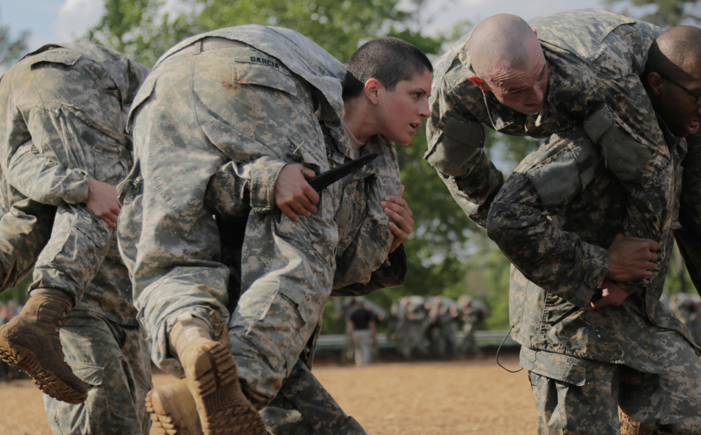 Soldier in combat training at Fort Benning, Georgia. Top Army and Marine Corps generals have told senators that they will not lower standards for combat posts for women or use quotas to get more women into frontline jobs.