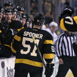 Bruins center Ryan Spooner is congratulated by teammates after scoring a second-period goal in Thursday night's 4-2 win over the Blackhawks.