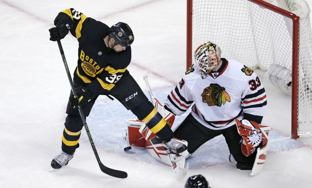 Chicago goalie Scott Darling makes a save as Bruins left wing Matt Beleskey tries to backhand the rebound in the third period.