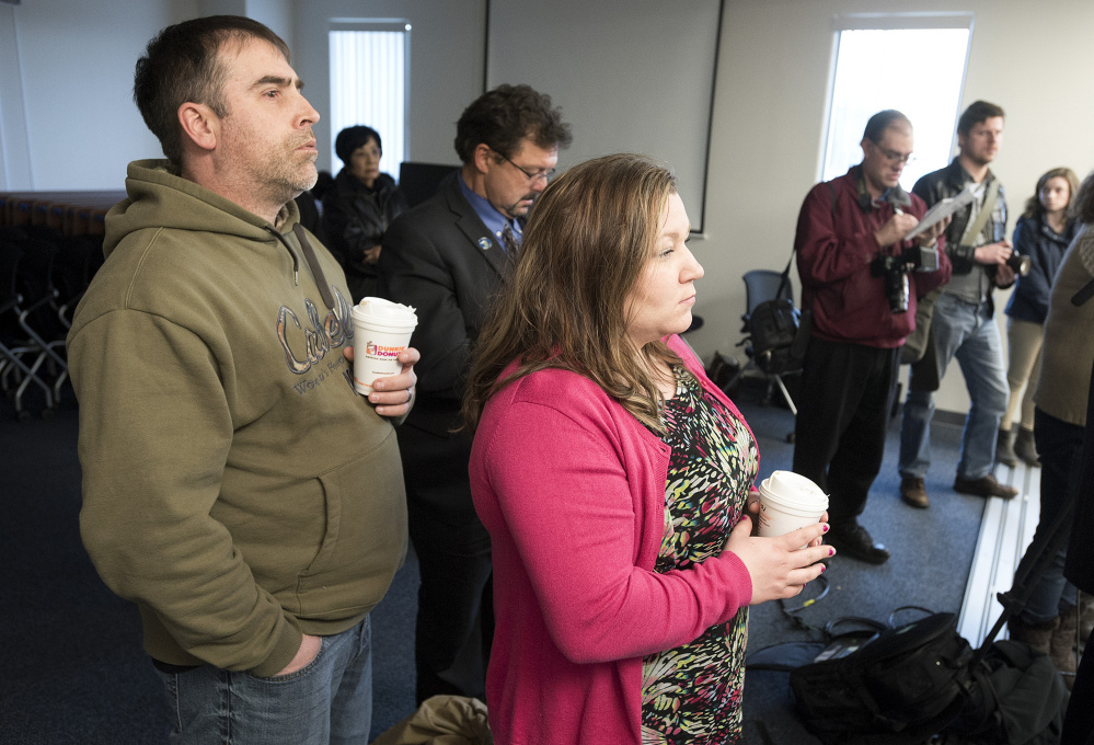 Greg Hale, a cousin of Joyce McLain, along with his wife, Heather, listen as Maine State Police Col. Robert Williams briefs the media on the arrest of Philip Scott Fournier in connection with the 1980 death of high school student Joyce McLain.