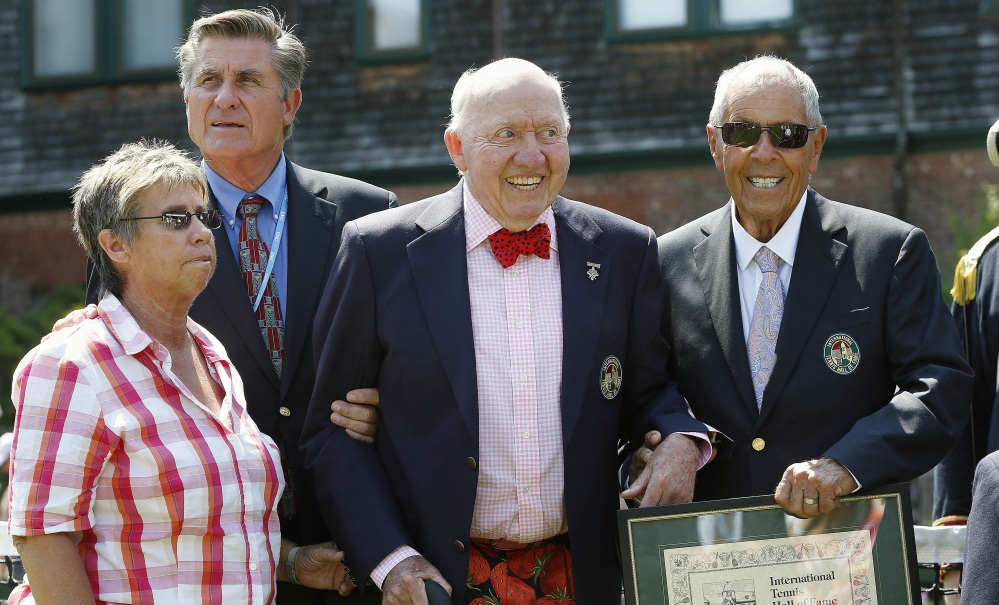 Bud Collins, center, is inducted into the International Tennis Hall of Fame in 2014 in Newport, R.I. With him are fellow inductees, from left, Rosie Casals, Charlie Pasarell and Nick Bollettieri.