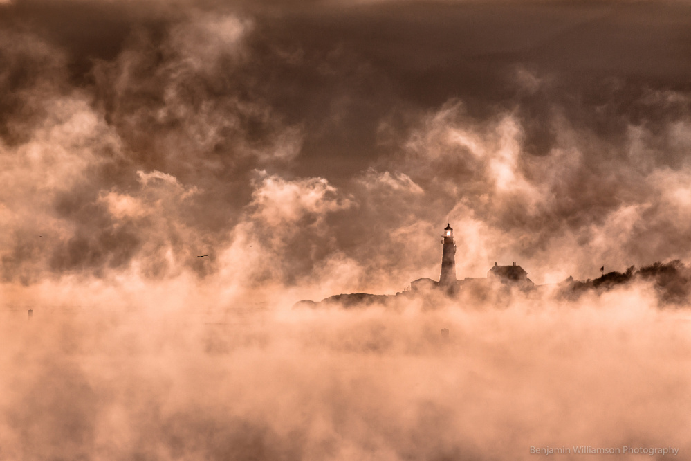 Smoke on the water, sea smoke, that is, and photographer Benjamin Williamson climbed onto the old battlements at Fort Preble to capture this dramatic image of Portland Head Light on a subzero morning when the lighthouse looked like a rocket launching through the water vapor.