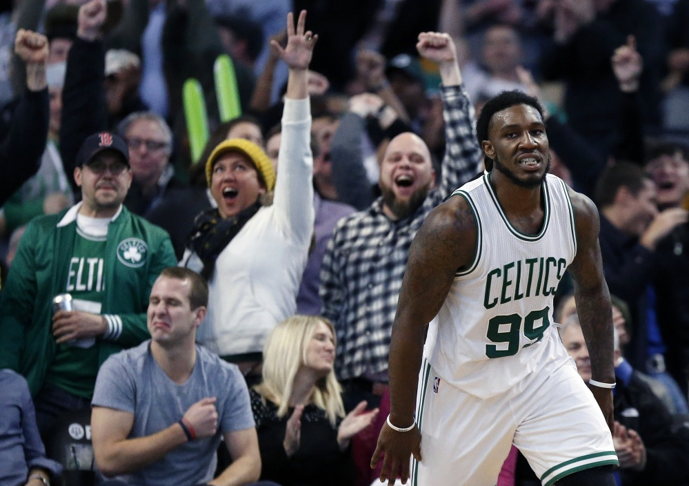 Boston fans erupt after the Celtics' Jae Crowder scores on a dunk in the fourth quarter of Friday night's game against the New York Knicks. The Celtics won in the final seconds, 105-104.