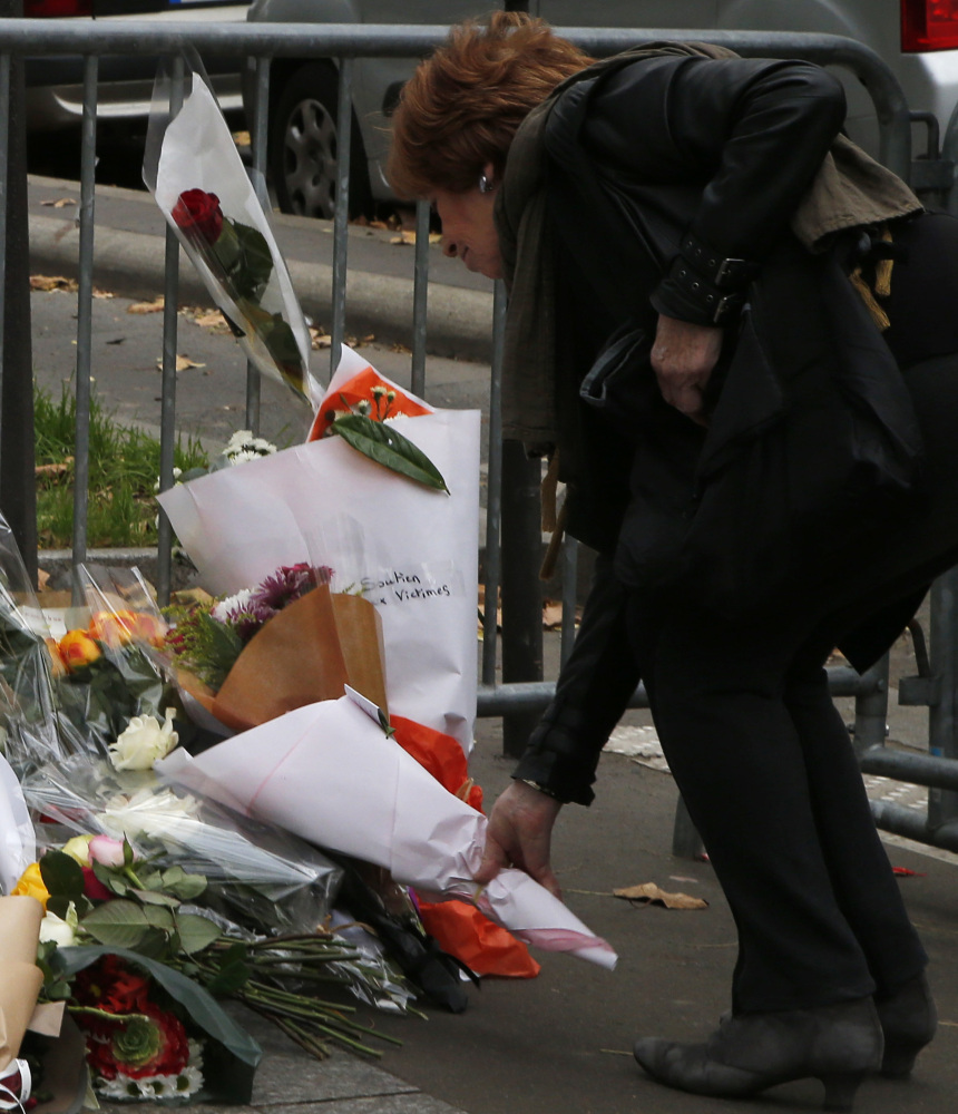 A woman lays flowers outside the Bataclan theater in Paris after the Islamic State's deadly attacks. The rise of ISIS represents a struggle for power.
