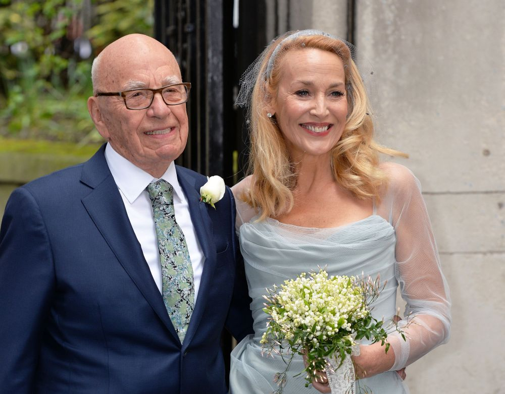 Media proprietor Rupert Murdoch and Jerry Hall pose outside St. Bride's Church in London for a ceremony to celebrate their wedding on Saturday.