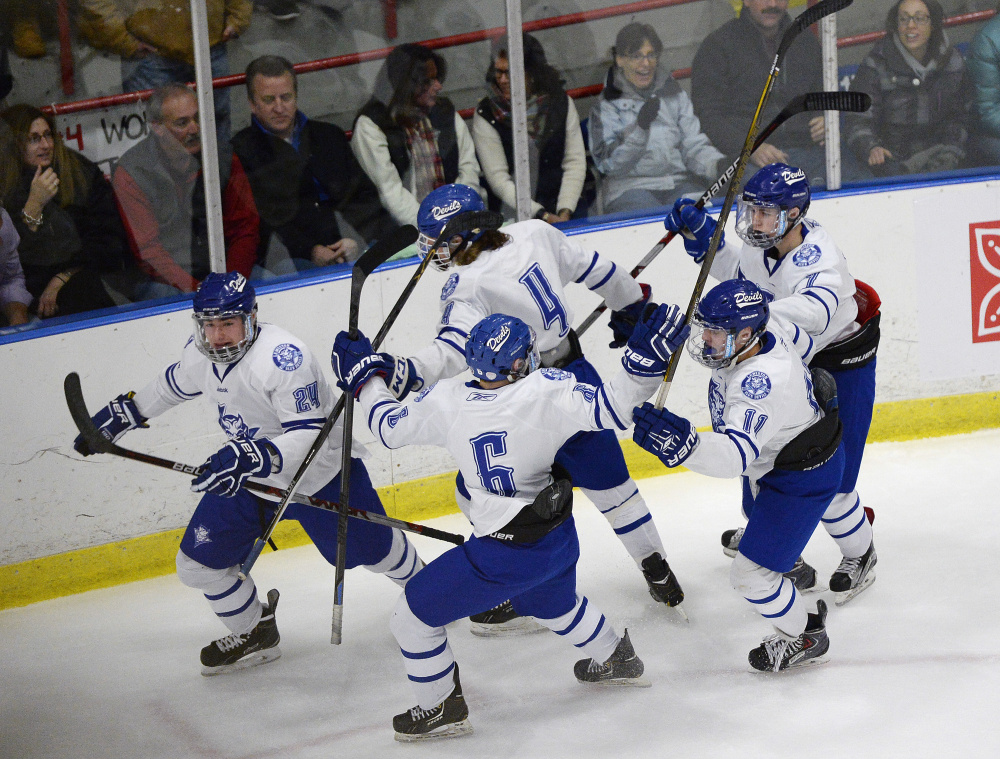 Lewiston players celebrate and early goal by Joe Bisson in the Class A boys' hockey state championship game Saturday night. Lewiston got a last-minute goal to beat defending champion Scarborough, 2-1.
