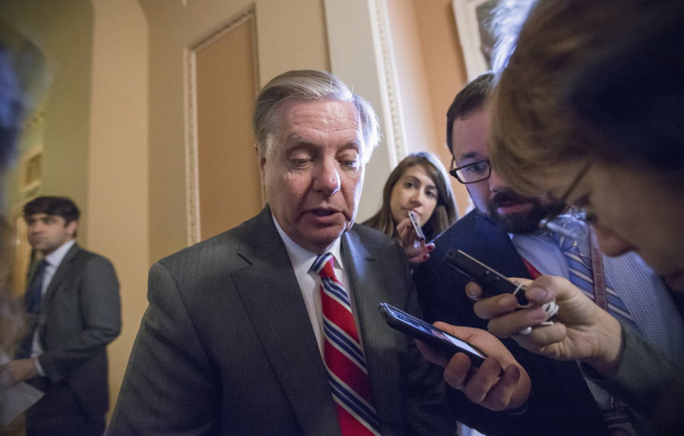Sen. Lindsey Graham, R-S.C., speaks to reporters on Capitol Hill in Washington. Republicans can blame their united stand against President Obama for the break-up of their party.