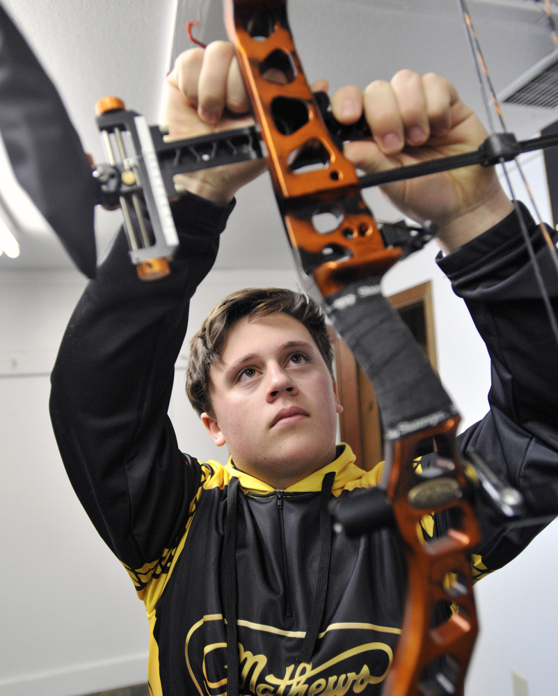 Malcolm Bourgeois makes adjustments to his bow. Shawn Patrick Ouellette/Staff Photographer