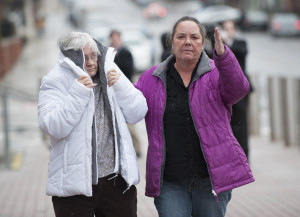 Philip Scott Fournier's mother, left, and sister leave the court house in Bangor after Fournier made his first appearance on a homicide charge.
