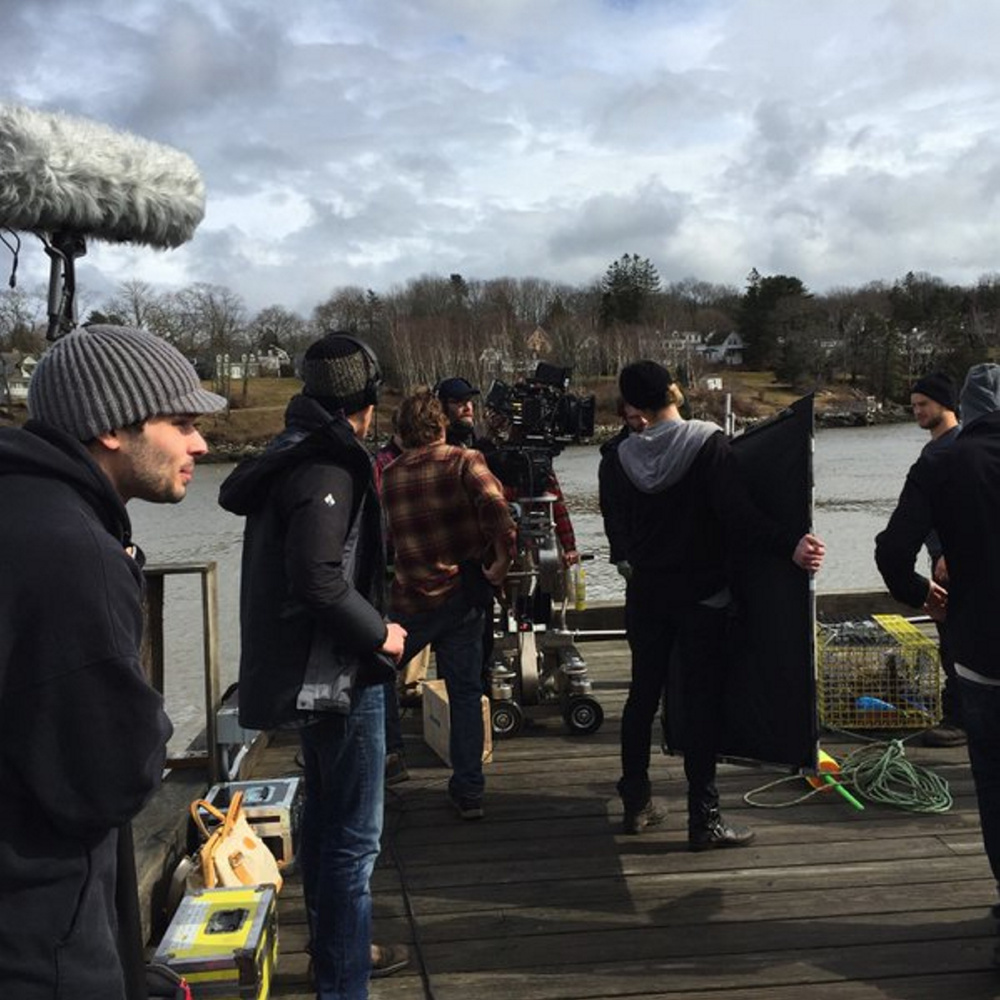 "Crew members prepare for filming on the independent horror movie ""Island Zero"" on the pier in Rockport last week. The screenplay was written by best-selling Camden author Tess Gerritsen and is directed by her son, Josh Gerritsen."