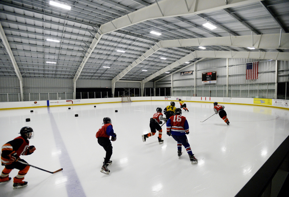 Players skate around the Casco Bay Arena in Falmouth, which opened in October. The added ice time in the Portland area is a boon for many players.