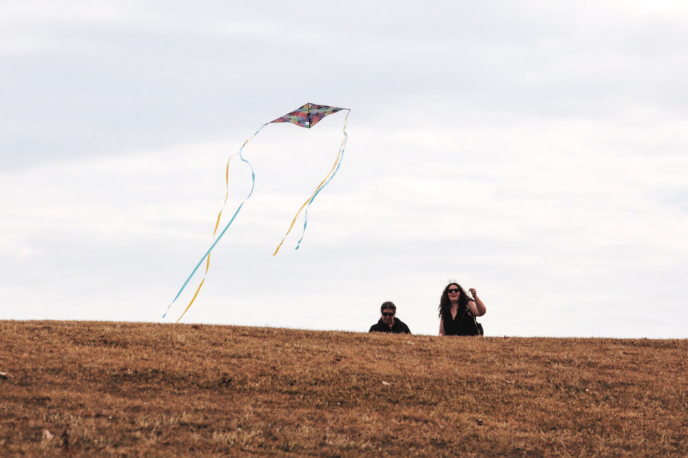 Hannah Surabian, right, and her mother, Brenda Surabian, fly a kite while taking advantage of the warm weather at Fort Williams Park in Cape Elizabeth on Wednesday.