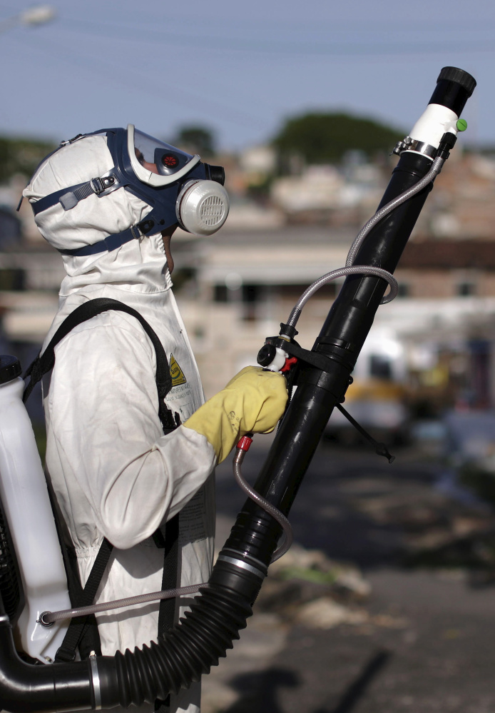 A worker sprays insecticide in Recife, Brazil, in an effort to fight the Zika virus, which is spread by mosquitoes.
