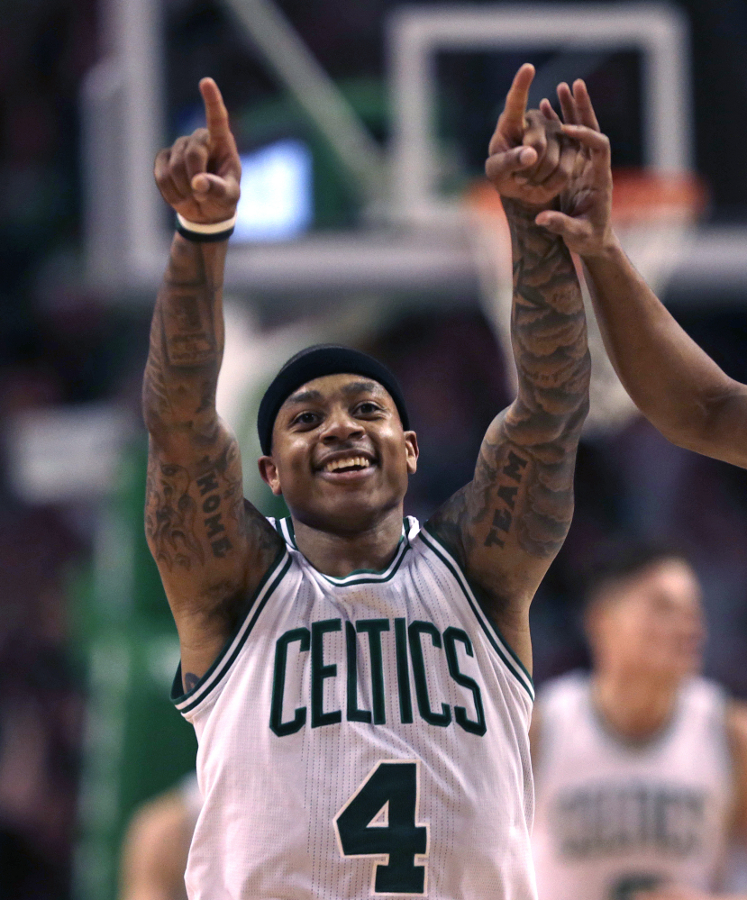 The Associated Press Isaiah Thomas of the Celtics celebrates after hitting a 3-point shot in the second half Wednesday night in Boston.