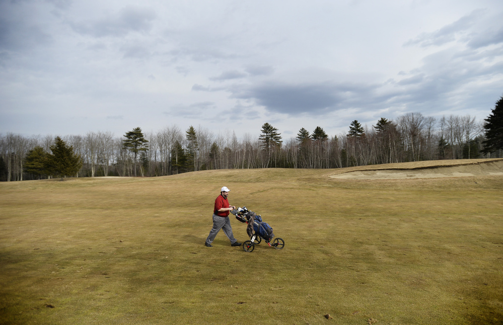 Rick Bourgault of Gorham walks along the golf course at Nonesuch River Golf Club Wednesday. Shawn Patrick Ouellette/Staff Photographer