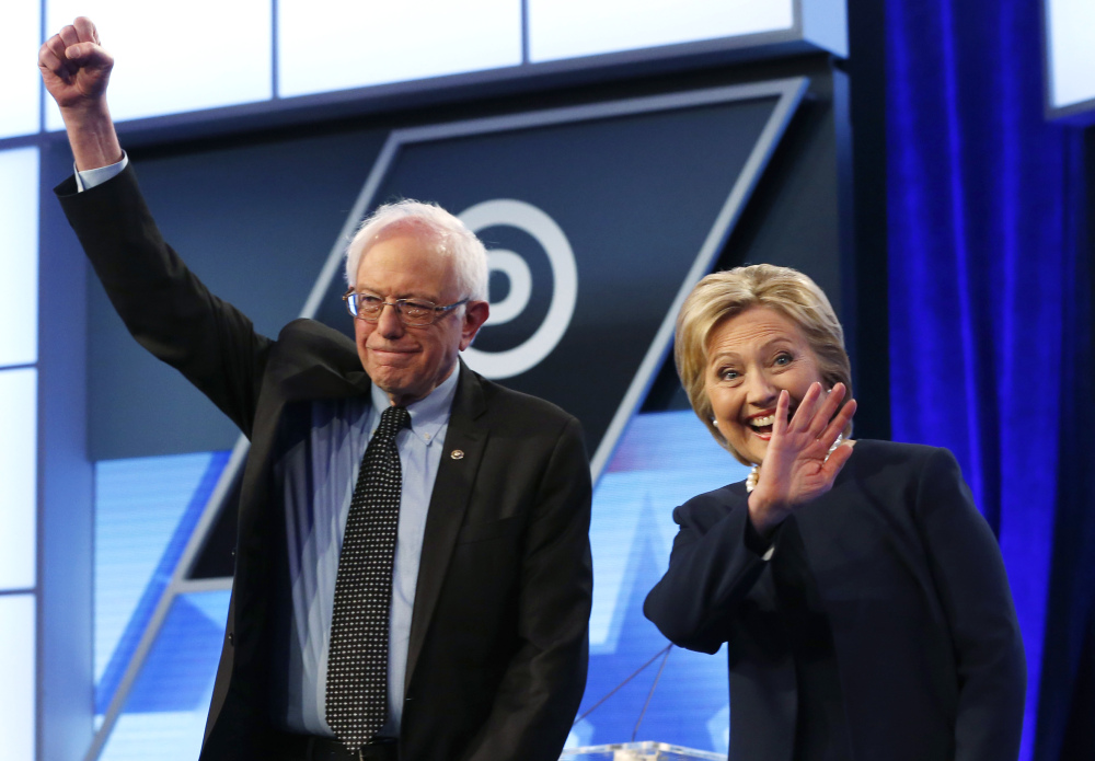 Hillary Clinton and Sen. Bernie Sanders, I-Vt., take the stage before the start of the Univision, Washington Post Democratic presidential debate in Miami on Wednesday.