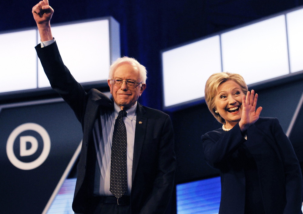 Democratic presidential candidates Bernie Sanders and Hillary Clinton respond to audience members at the Miami Dade College Kendall Campus in Miami on Wednesday.