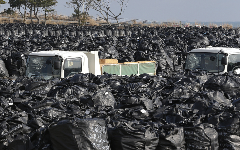 Trash bags filled with collected radioactive materials are packed at a temporary waste storage site in Tomioka, Fukushima prefecture, northeastern Japan. Some 7,000 day laborers are cleaning up the irradiated town.