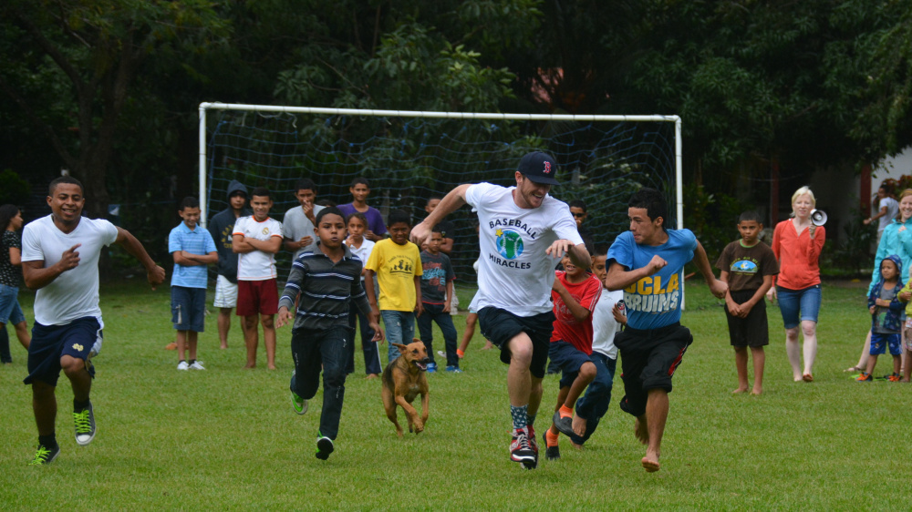 While in Honduras with Baseball Miracles, a group that spreads the joy of baseball to impoverished areas, Michael McCarthy had a fun race against the fastest child at Finca Del Nino, the name of the orphanage and school. Many others joined in, including one of the school's dogs.