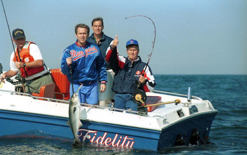 Maine's fishing always gets a thumbs-up from George H.W. Bush, shown reeling in a bluefish with help from George W., in the summer of 1991, when the waters off Walker's Point provided a necessary respite from the turmoil of the era.