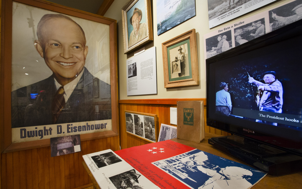 A video showing President Dwight Eisenhower holding a fish he caught in the Rangeley area with guide Don Cameron plays as part of an exhibit dedicated to Ike's 1950s trip to the area at the Outdoor Sporting Heritage Museum in Oquossoc.