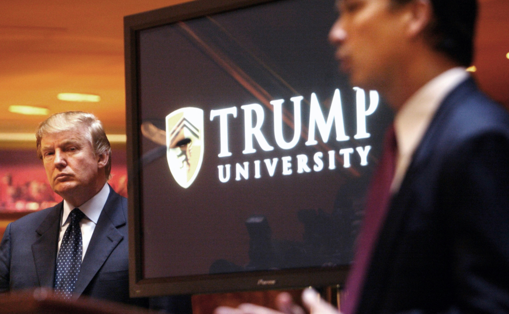 Donald Trump listens as he is introduced at a news conference in New York in 2005, where he then announced the establishment of Trump University.