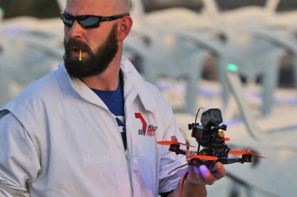 A team member carries a drone during the final day of the first World Drone Prix in Dubai, United Arab Emirates, on Saturday.
