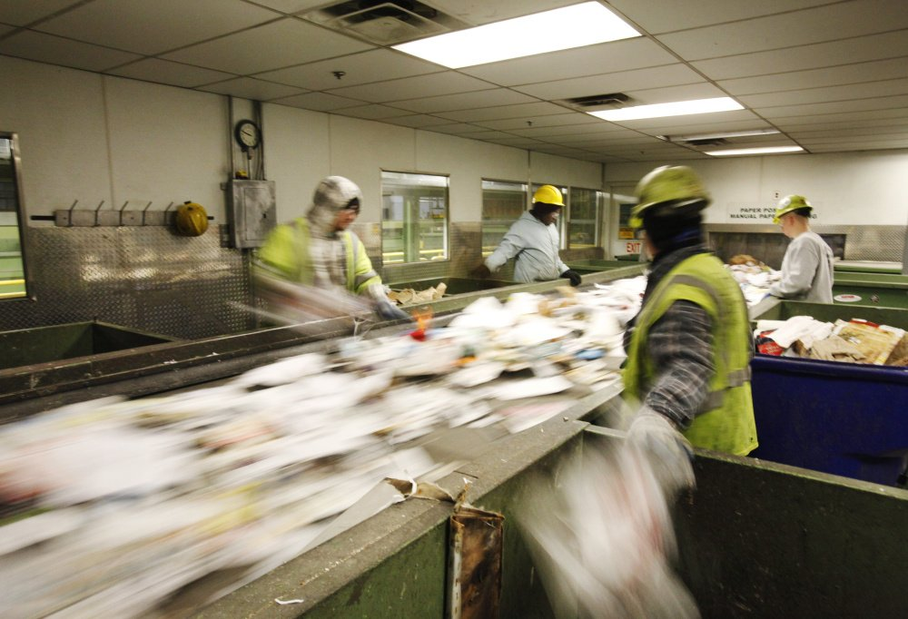 Sorters separate recyclable materials recently at ecomaine's recycling facility in Portland.