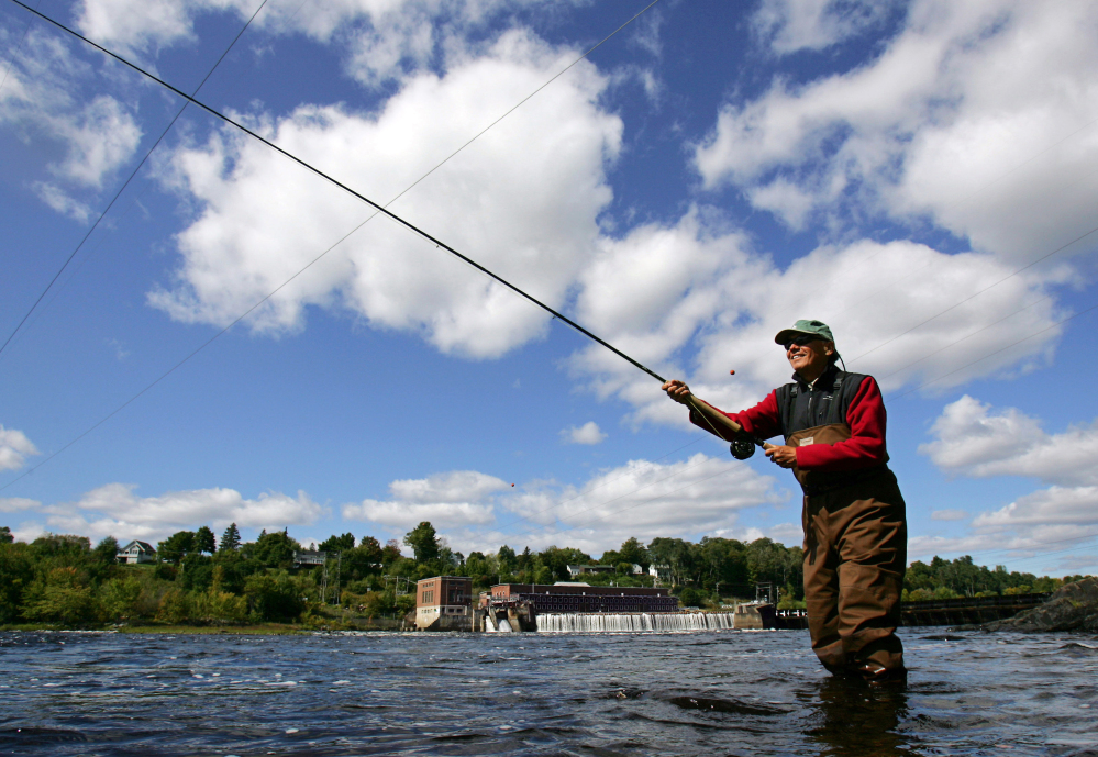 A fisherman casts for Atlantic salmon in the Penobscot River below the Veazie Dam in Eddington.