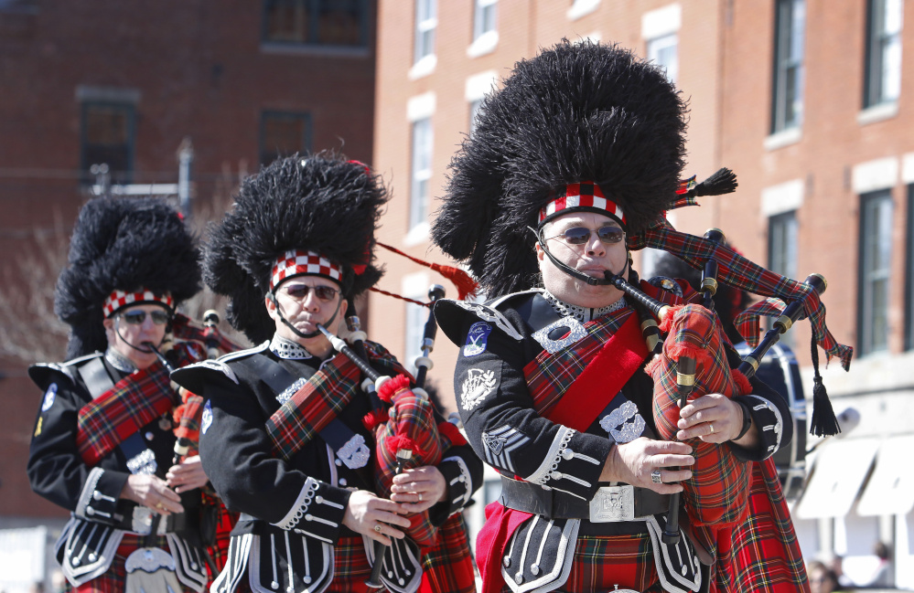 PORTLAND, ME - MARCH 13: Members of the Kora Highlanders of Lewiston fill Commercial Street with bagpipe music during the St. Patrick's Day parade in Portland. (Photo by Jill Brady/Staff Photographer)