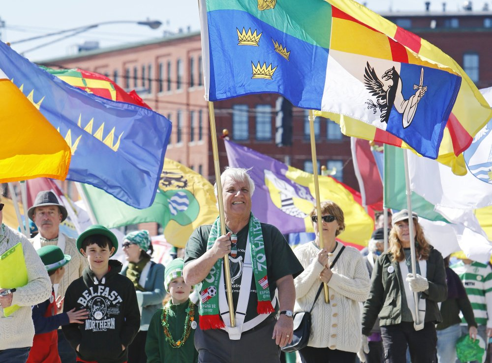 PORTLAND, ME - MARCH 13: Colorful Irish flags are carried in the St. Patrick's Day parade in Portland. (Photo by Jill Brady/Staff Photographer)