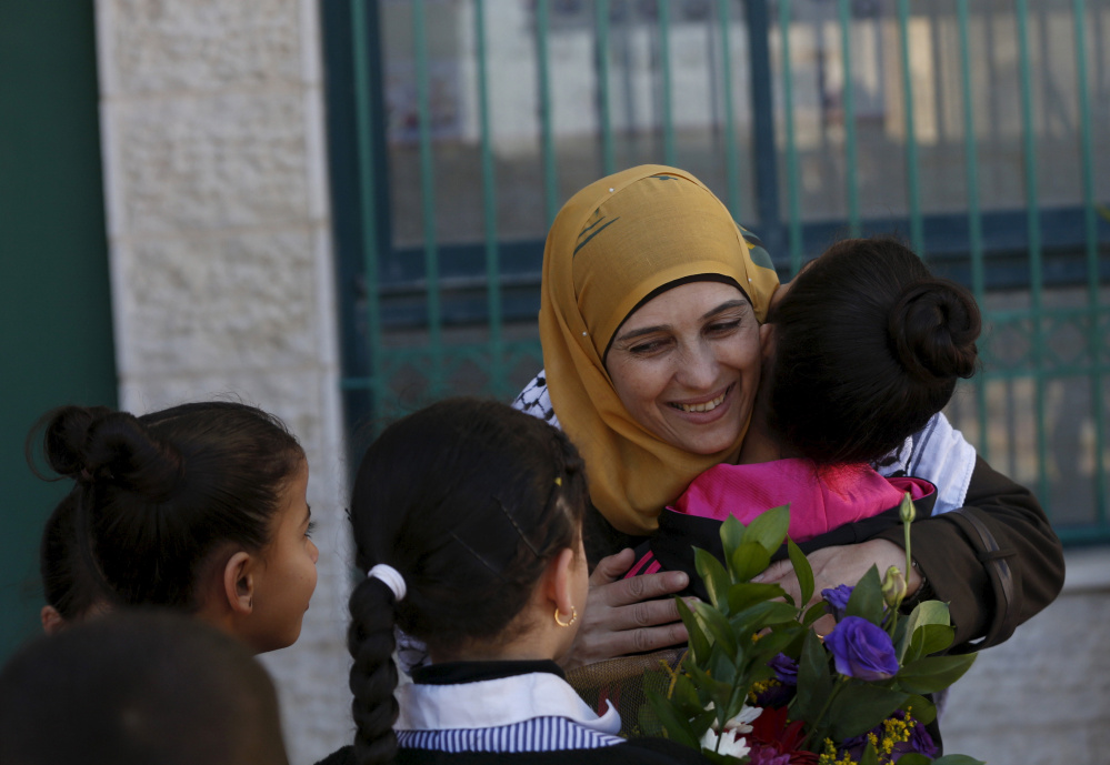 Palestinian teacher Hanan al-Hroub is hugged by a student in the West Bank city of Ramallah.