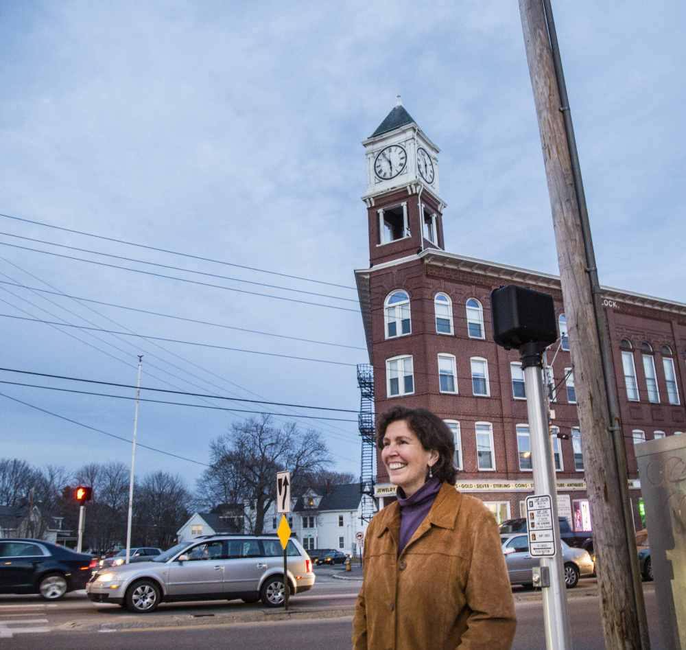 Teresa Valliere stands in the Woodfords Corner area on Wednesday. Whitney Hayward/Staff Photographer