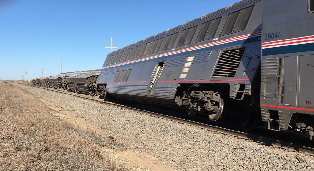 An Amtrak train derailed in southwest Kansas early Monday, injuring at least 32 people.
