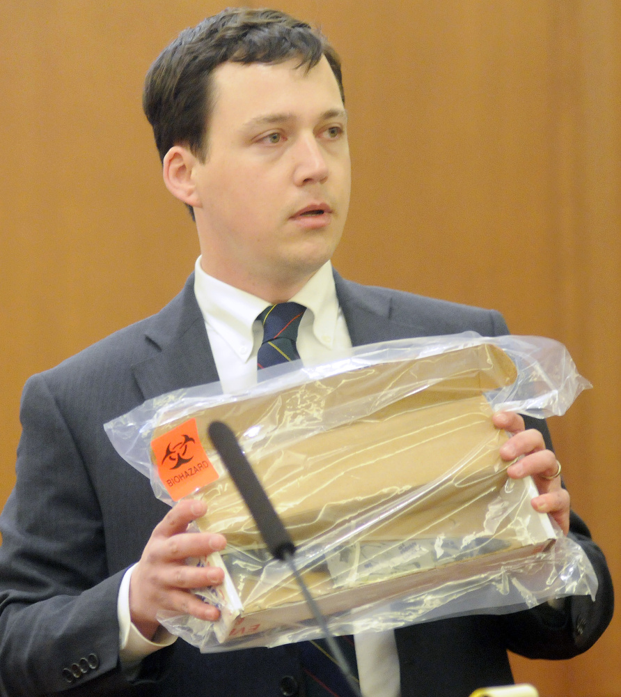 Defense attorney Caleb Gannon holds a knife that he claims Jillian Jones assaulted Justin Pillsbury with at their Augusta apartment.
