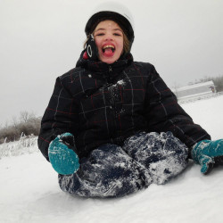 """Cyndimae Meehan slides in the snow shortly after moving to Maine. Her epilepsy left her """"a shell of a child"""" before cannabis treatment allowed her to run, laugh and swim."""