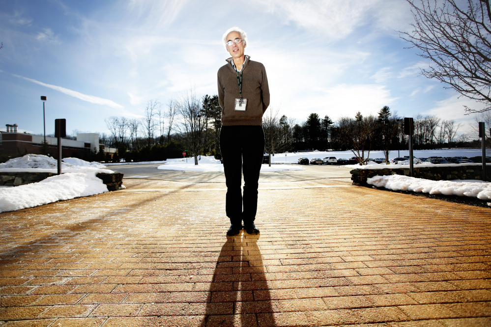 Cliff Rosen, M.D., who has been conducting clinical research for 10 years on the effects of vitamin D, soaks up some welcome sunlight in January outside the Maine Medical Center research building in Scarborough.
