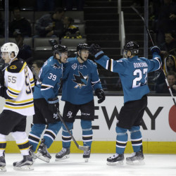 The Sharks' Melker Karlsson, center, celebrates his goal with teammates Joonas Donskoi (27) and Logan Couture (39) in the first period of Tuesday night's game in San Jose, Calif. Donskoi scored the game winner in the third period.