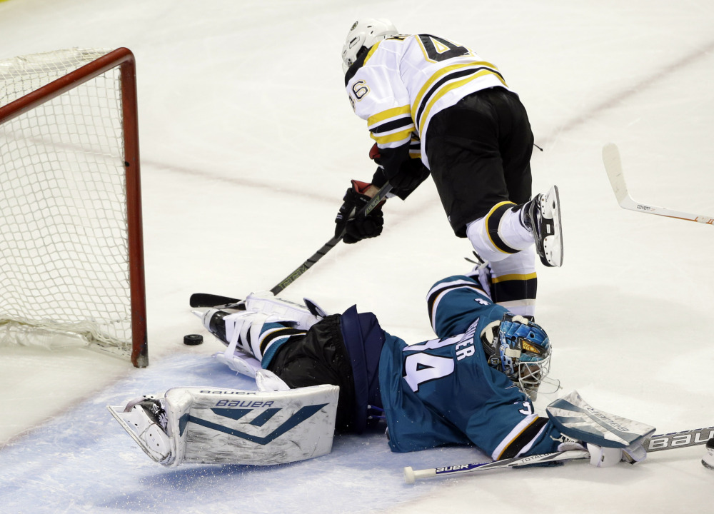 Sharks goalie James Reimer stops a shot by the Bruins' David Krejci in the third period. San Jose won, 3-2.