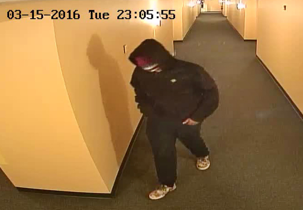 Police are looking for this man, seen in surveillance video minutes before police were notified of a shooting Tuesday in an apartment on Gilman Street. Courtesy Portland police