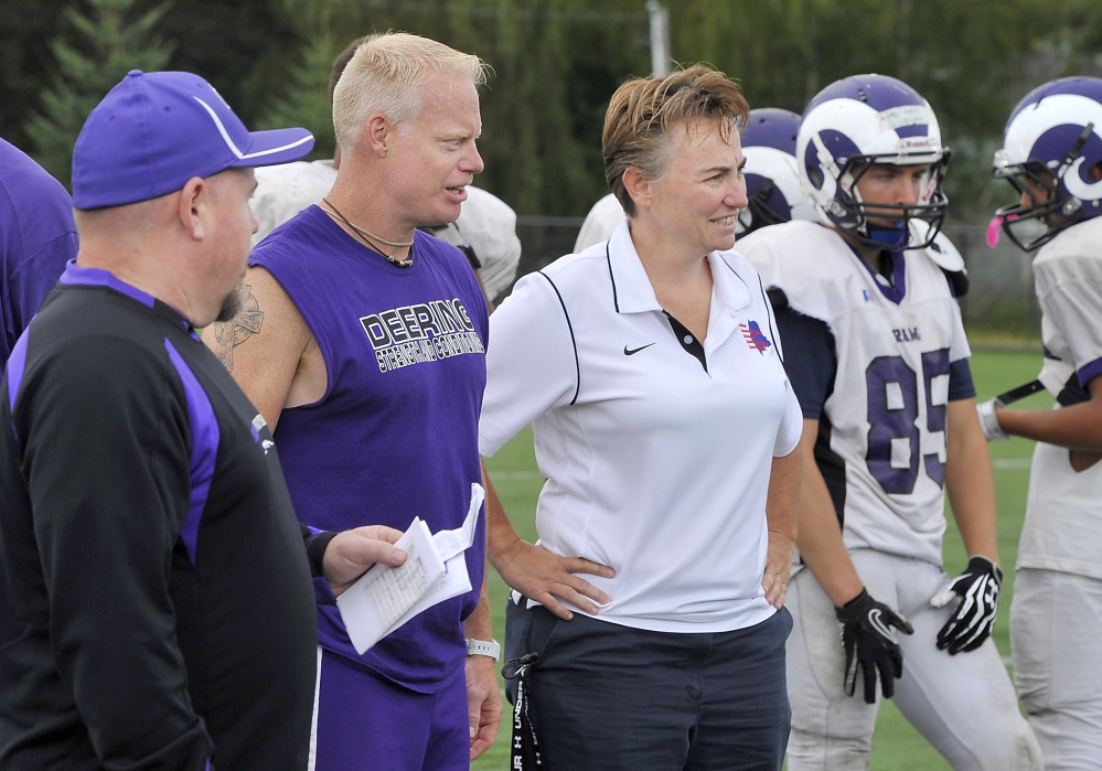 Melanie Craig, Deering High School's athletics administrator, talks to coaches at a football practice in August. Her testimonial on school letterhead was an innocent mistake, officials say.