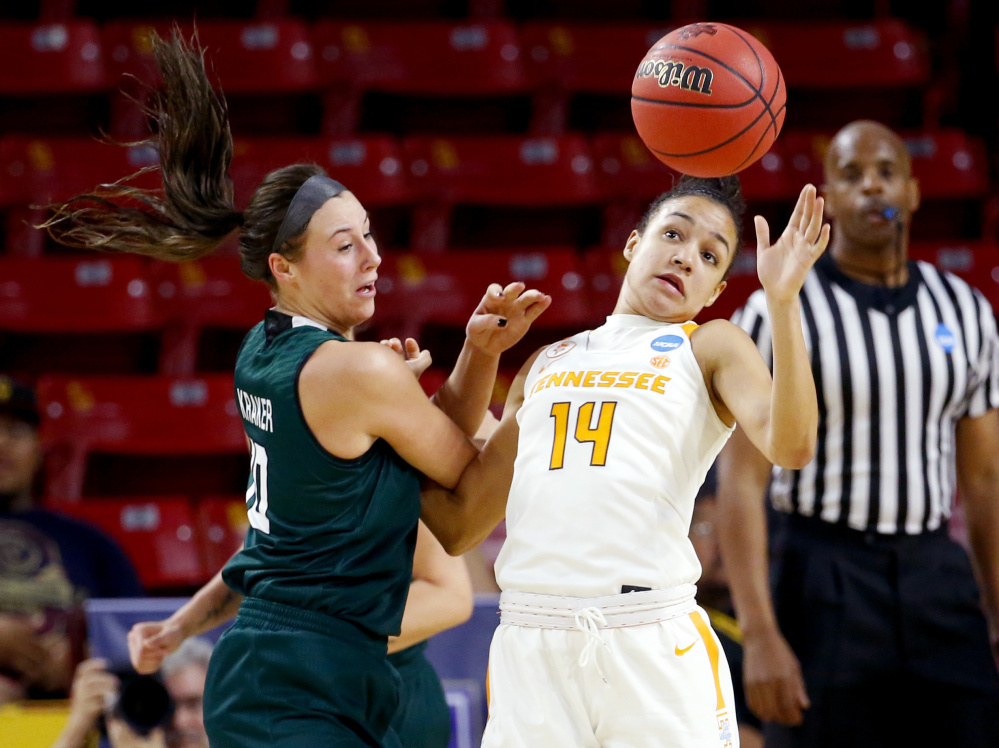 Tennessee guard Andraya Carter, right, knocks the ball away from Wisconsin-Green Bay's Mehryn Kraker during a first-round game Friday in the NCAA women's basketball tournament in Tempe, Arizona. Tennessee won, 59-53.