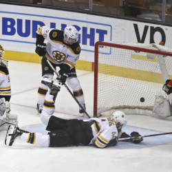 Anaheim center Ryan Kesler slaps in a goal as Bruins goalie Jonas Gustavsson is caught out of position and defenseman Dennis Seidenberg dives for the puck in the first period of Friday night's game in Anaheim, Calif.