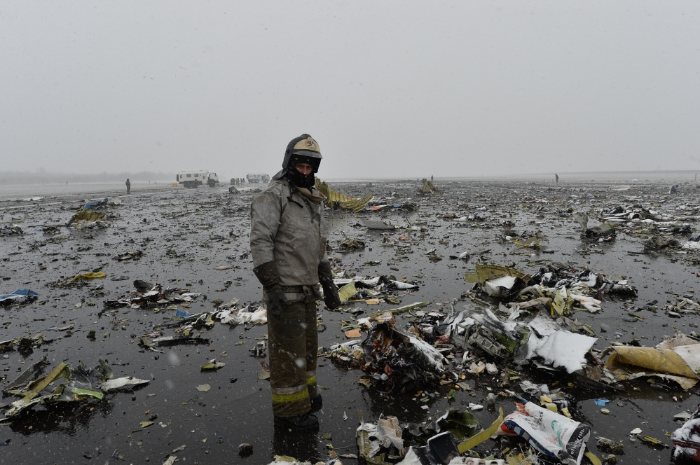 A Russian Emergency Ministry employee  stands next the wreckage of a crashed plane at the Rostov-on-Don airport, about 600 miles south of Moscow on Saturday.
