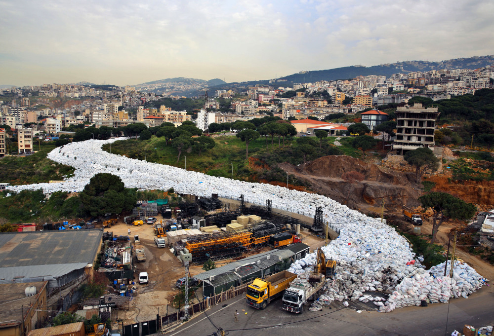 A veritable river of garbage has been flowing in east Beirut since July when a dump was closed with no realistic alternatives at the city's disposal. Finally, on Saturday, public workers began removing the refuse and moving it to the dump, which was reopened for two months.