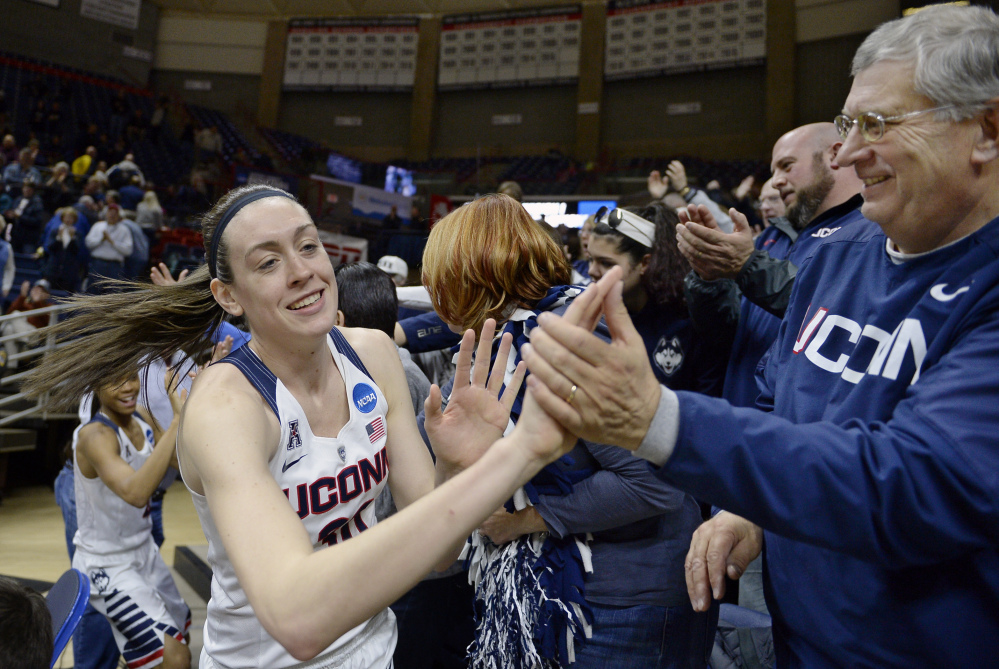 Connecticut's Breanna Stewart greets fans at the end of the Huskies' 101-49 rout of Robert Morris on Saturday in the first round of the women's NCAA tournament. Connecticut led by 49 points at halftime.