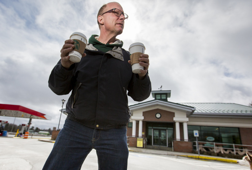 Mike Tehan of Winthrop holds two cups of coffee after leaving Starbucks at the Cumberland service plaza on the Maine Turnpike on Thursday. The rest stops at Mile 58 southbound in Cumberland and Mile 59 northbound in Gray will close Monday for nine weeks so the two Starbucks can be turned back into Burger Kings. Ben McCanna/Staff Photographer