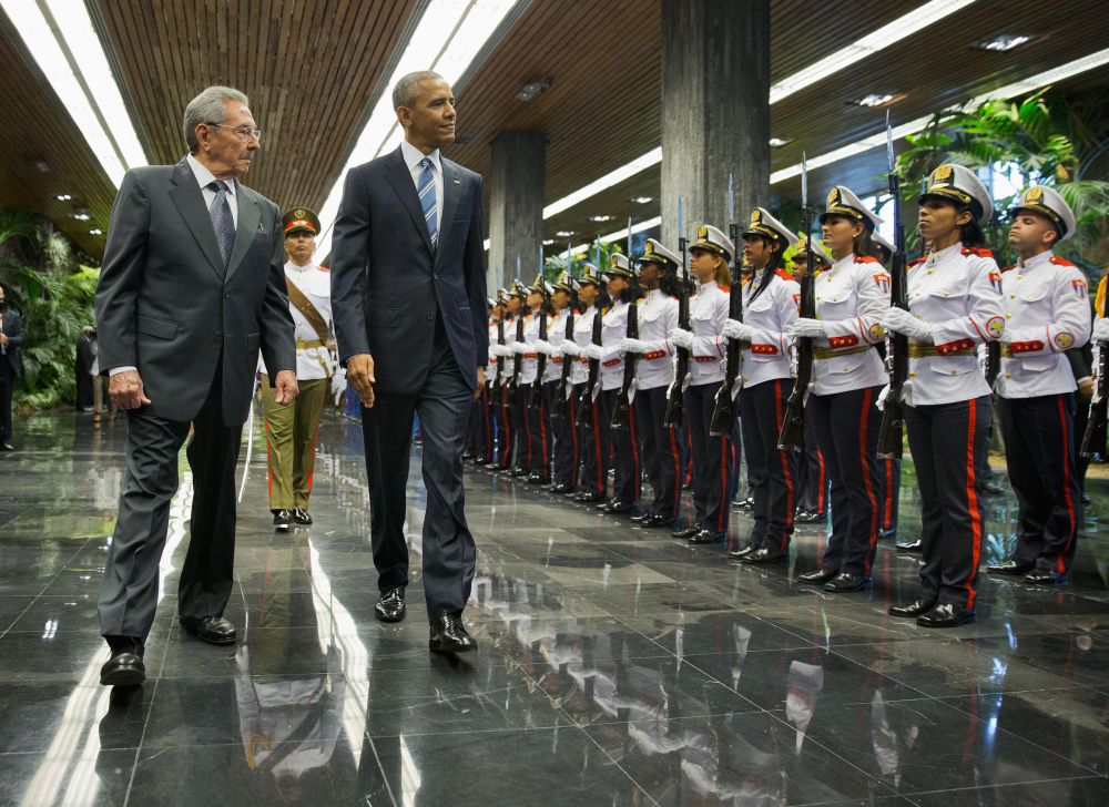 President Barack Obama and Cuban President Raul Castro, left, walk during a welcoming ceremony at the Palace of the Revolution, Monday, March 21, 2016, in Havana, Cuba. (AP Photo/Pablo Martinez Monsivais)